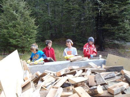 Junior members loading firewood onto trailer